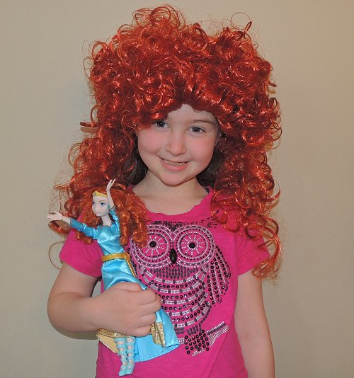 daughter with Merida wig and doll